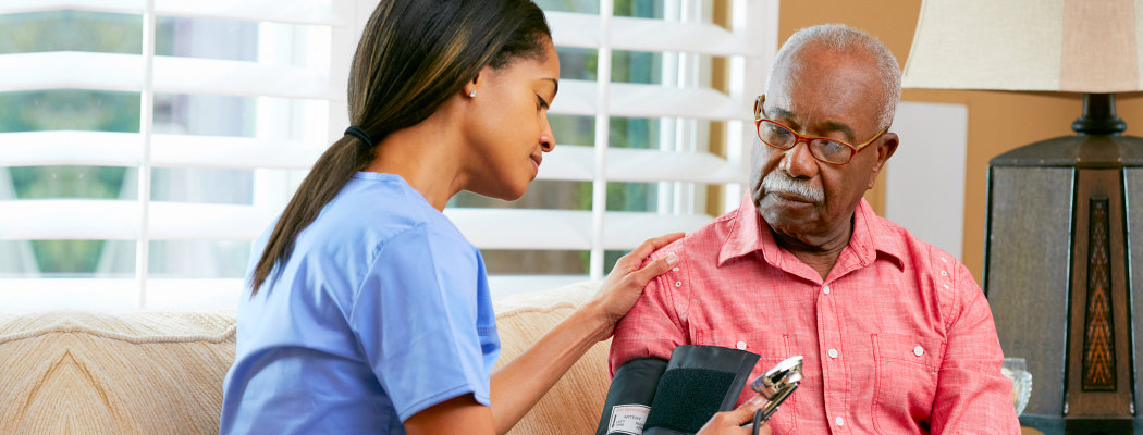 checking elder male blood pressure