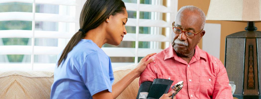 checking elder male blood pressure