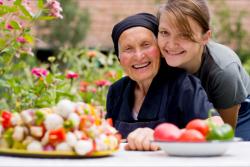 nurse and elderly woman smiling