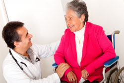 doctor checking the health of an elderly woman